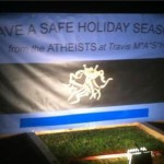 "Nighttime scene of the atheist display: ""Have a Safe Holiday Season"""