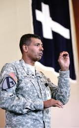 Major General Vince Brooks as commanding general under Christian flag